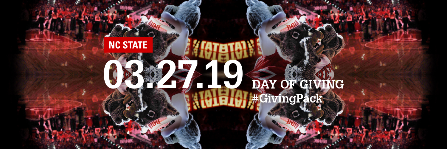 Twitter cover photo depicting Mr. and Ms. Wuf cheering at a basketball game with text reading NC State 03.27.19 Day of Giving Hashtag Giving Pack